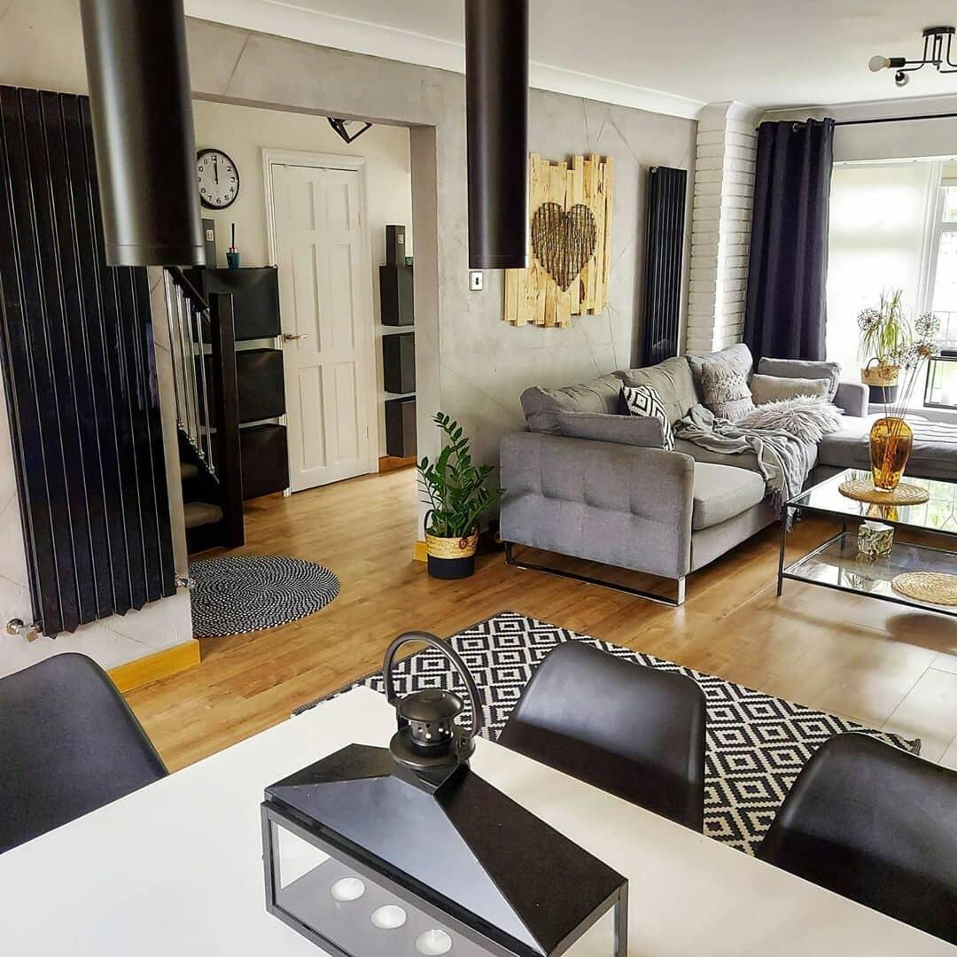 2 black radiators in a rustic living room