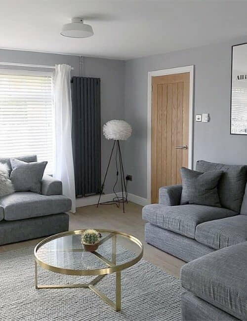anthracite vertical radiator in a grey living room