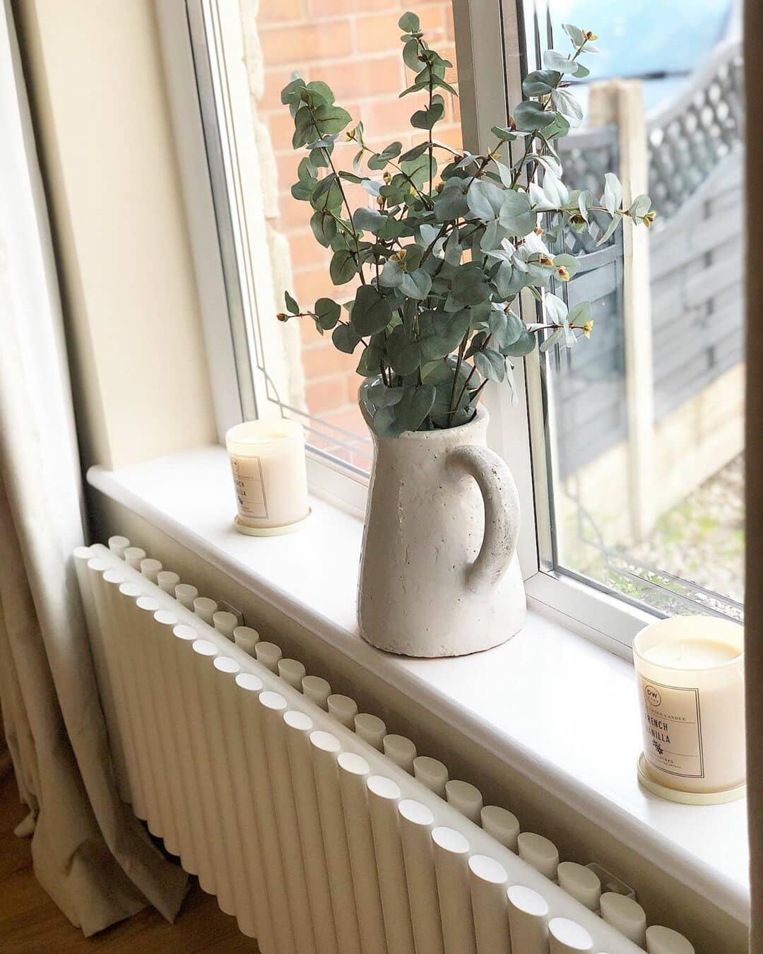 close up of a white designer radiator under a window