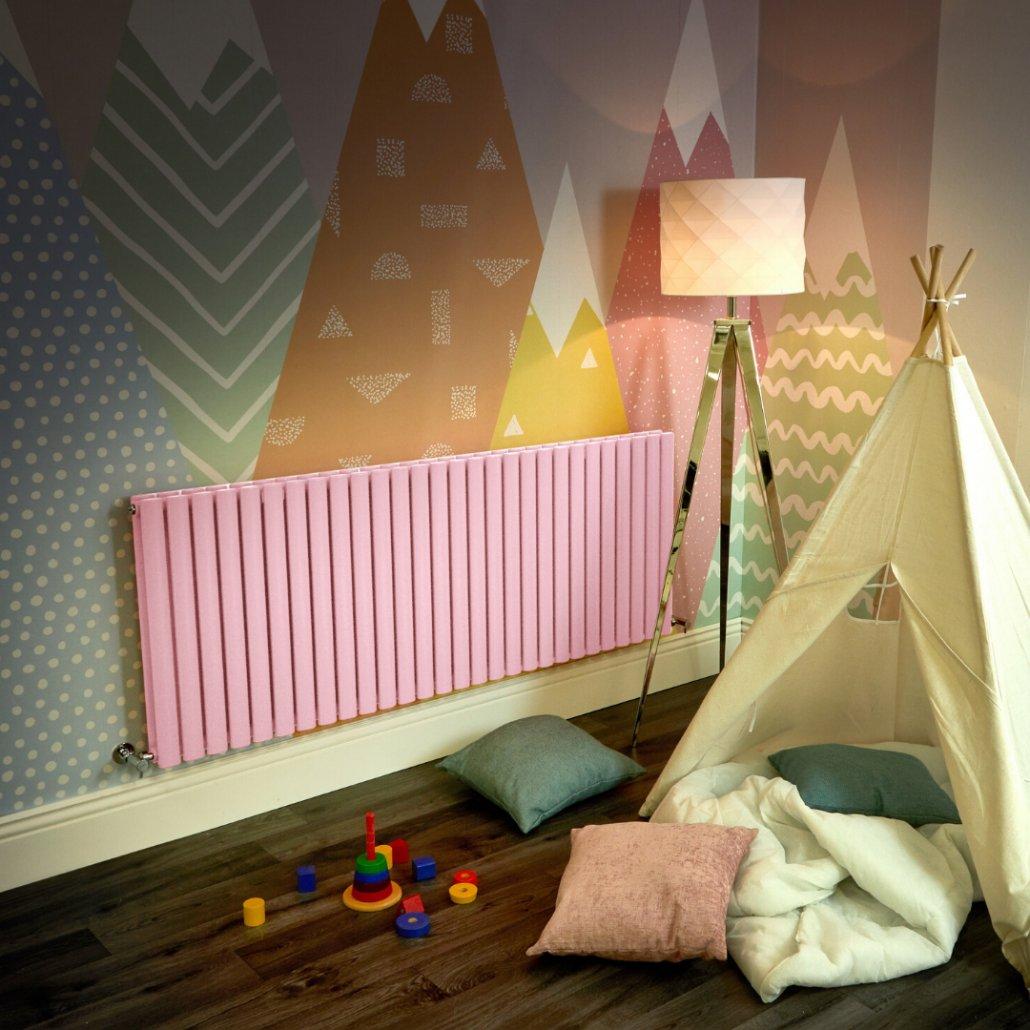 pink Milano Aruba radiator in a playroom