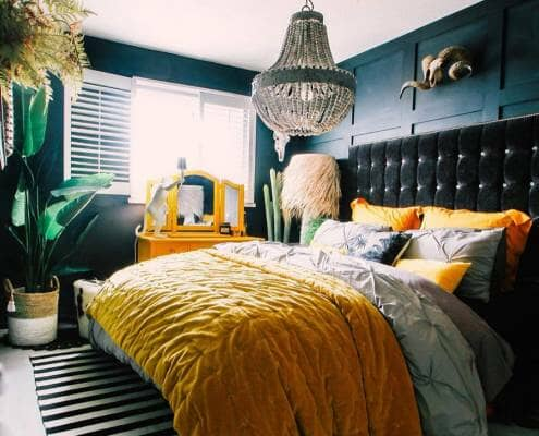 eclectic bedroom with yellow bedding