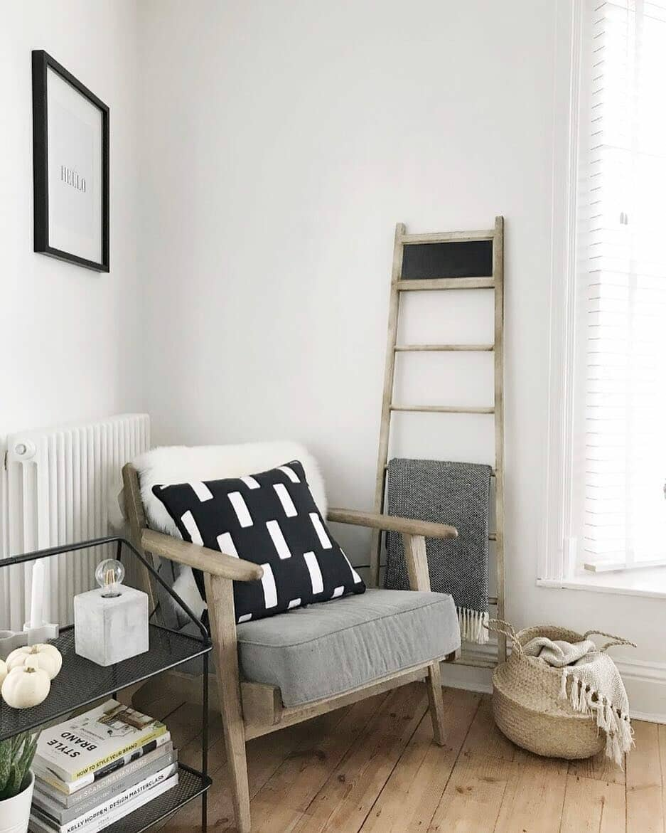 wooden chair and ladder next to a white radiator