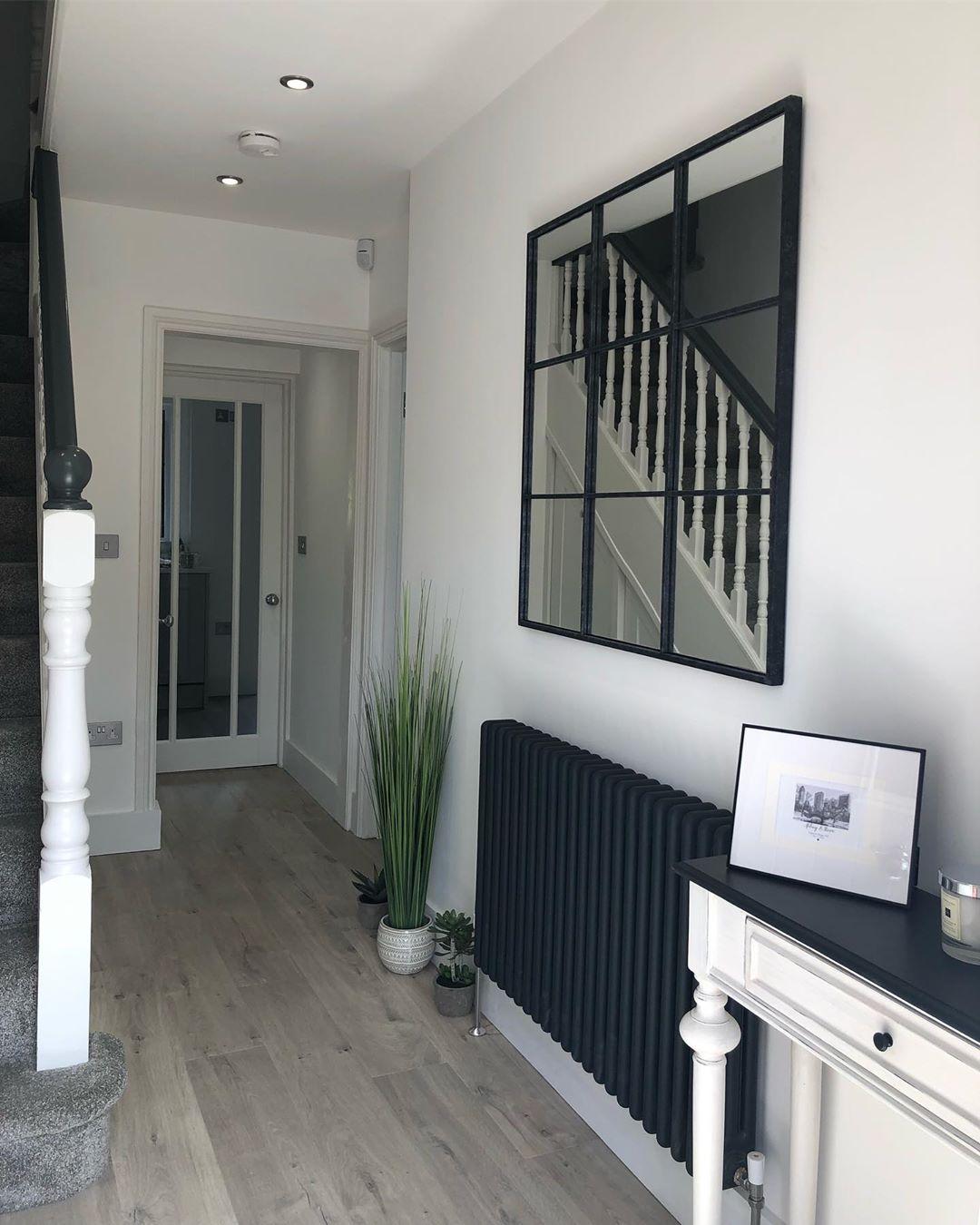 Milano Windsor column radiator in a modern hallway
