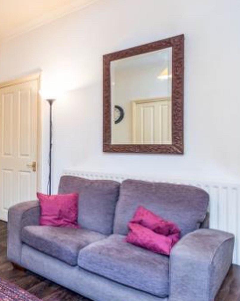 purple sofa in a white living room