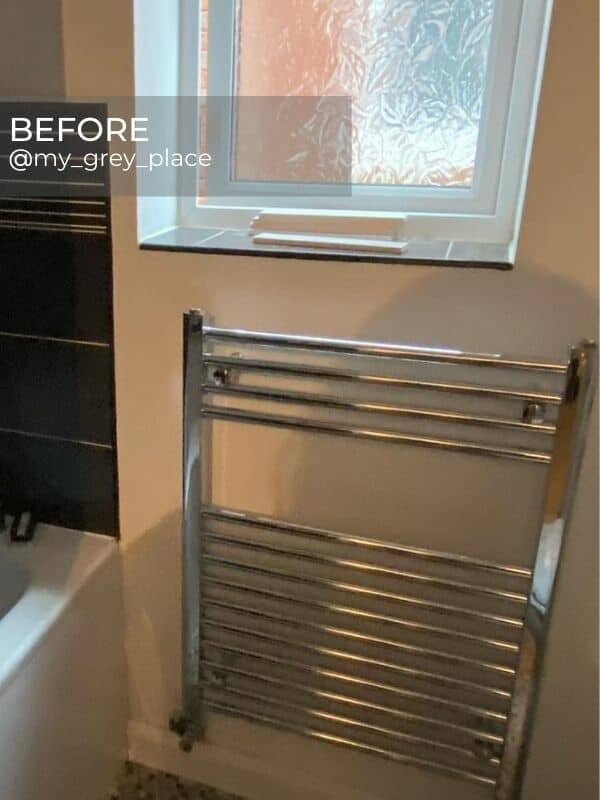 chrome towel rail in an old bathroom