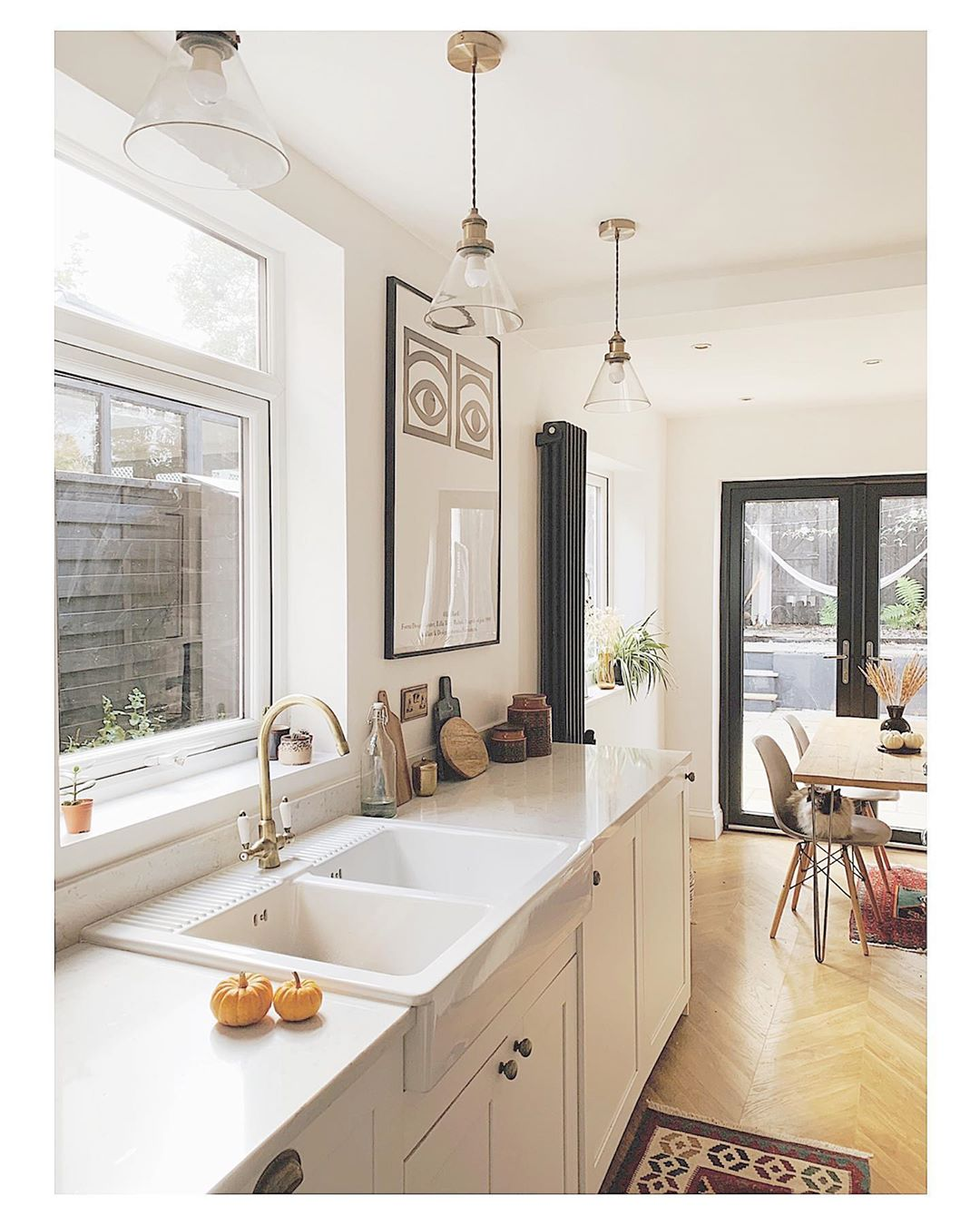 anthracite vertical radiator in a white kitchen