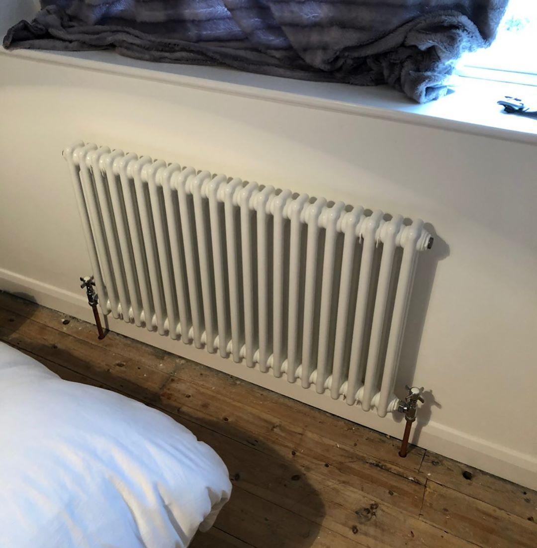 white column radiator on a white wall