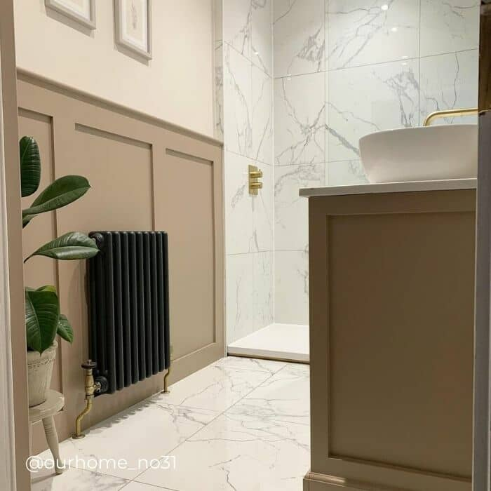 anthracite column radiator on a panelled bathroom wall