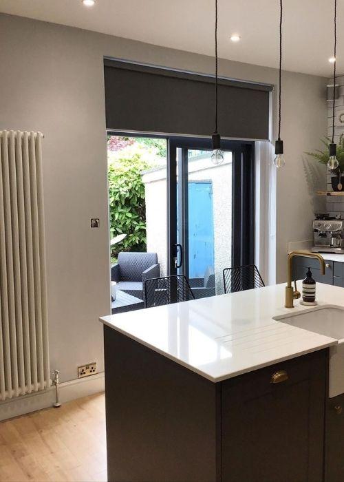 windsor vertical column radiator in a kitchen