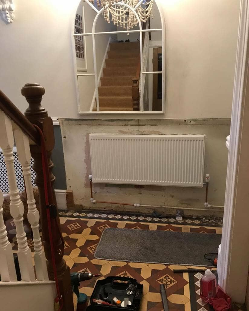 an old radiator in a hallway