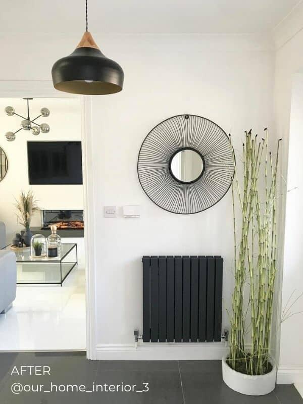 anthracite horizontal designer radiator in a hallway