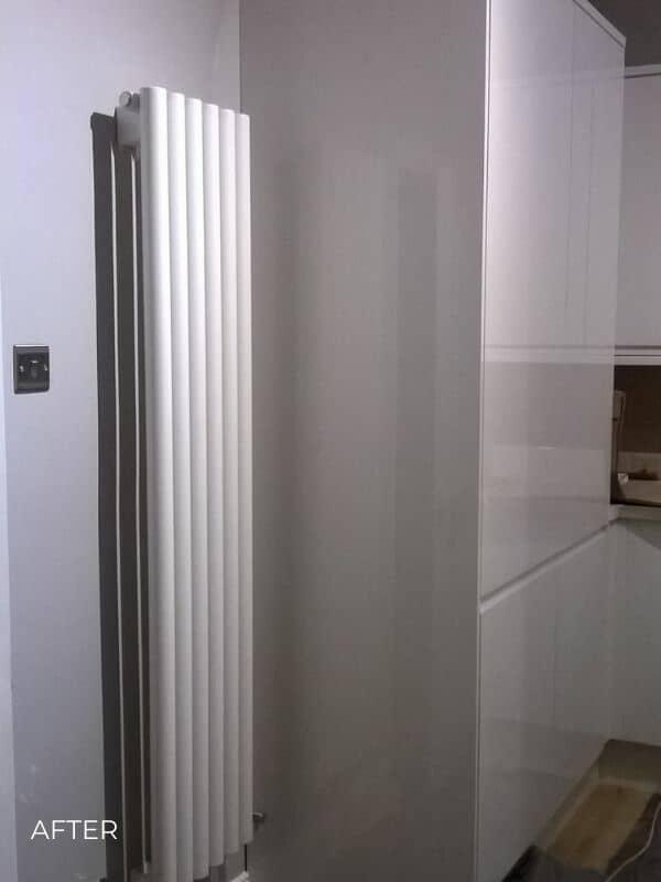vertical designer radiator in a kitchen