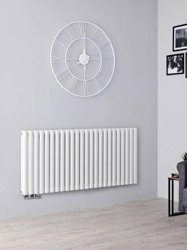 a white horizontal radiator on a grey wall