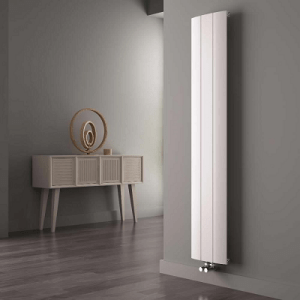 A tall white vertical radiator in a hallway