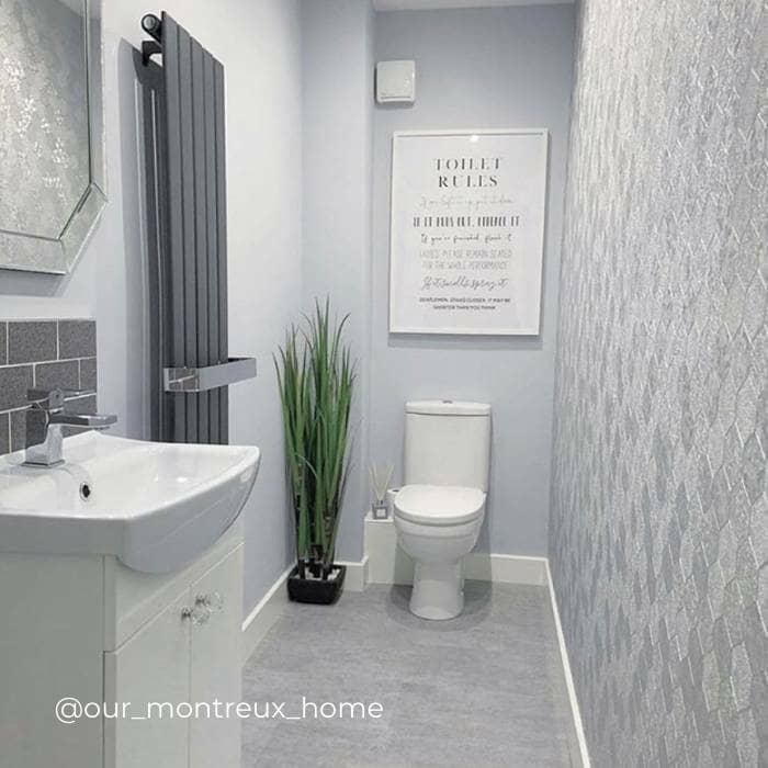 vertical designer radiator in a grey bathroom