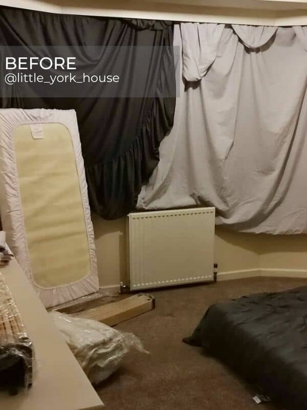 white convector radiator in a bedroom during a renovation