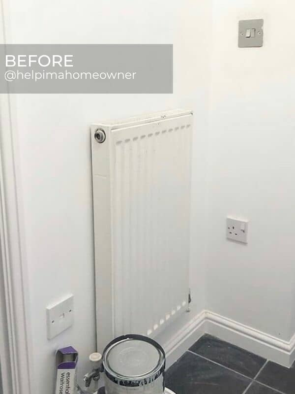 old convector radiator in a corner