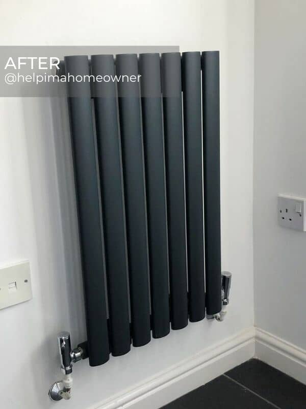 anthracite designer radiator in a corner