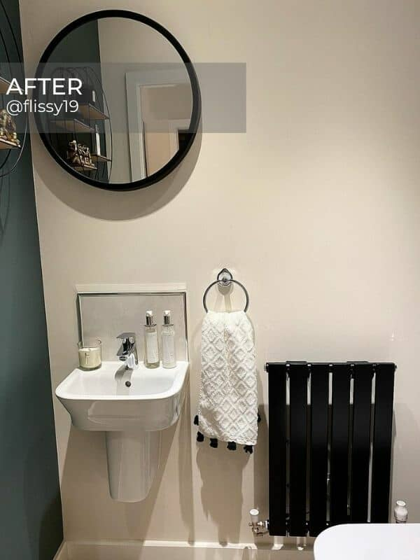 black radiator in a small bathroom
