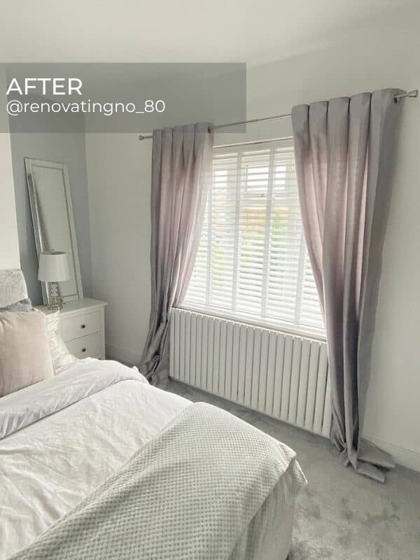 white designer radiator under a bedroom window