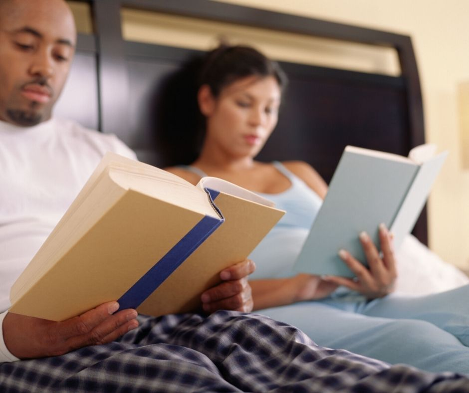 couple reading in bed