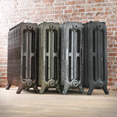 four cast iron radiators beside each other in a row