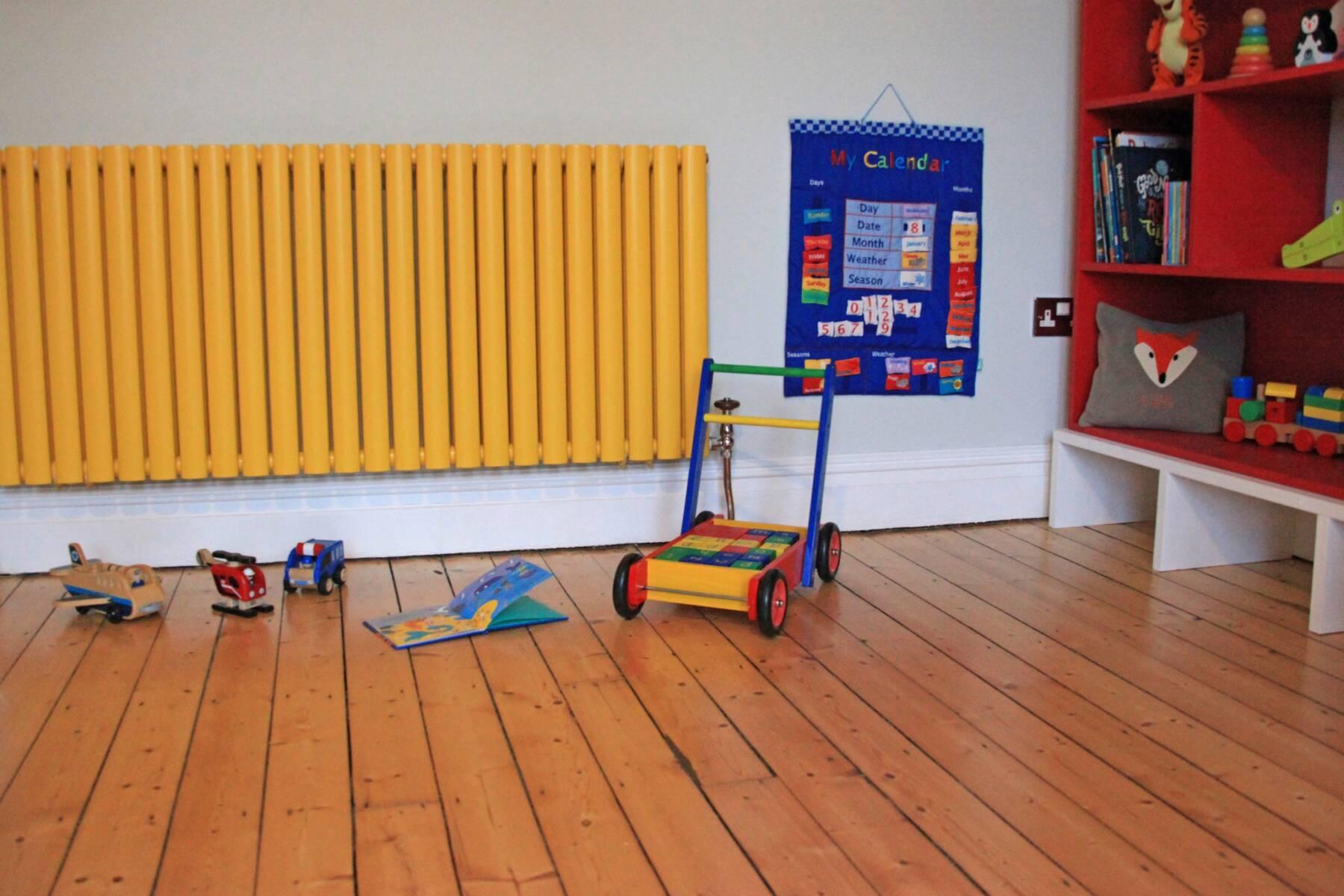 yellow radiator in a playroom