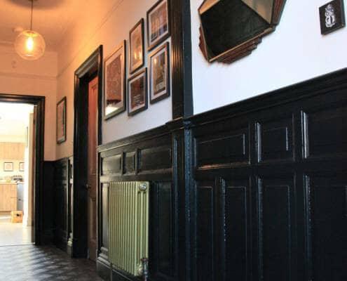 Milano Windsor gold column radiator in a hallway