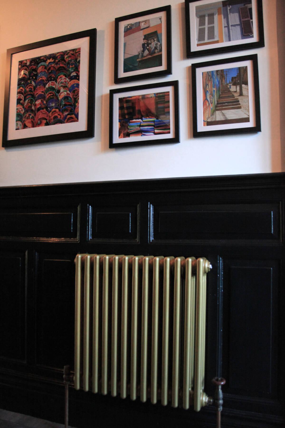front of a gold column radiator in a dark hallway