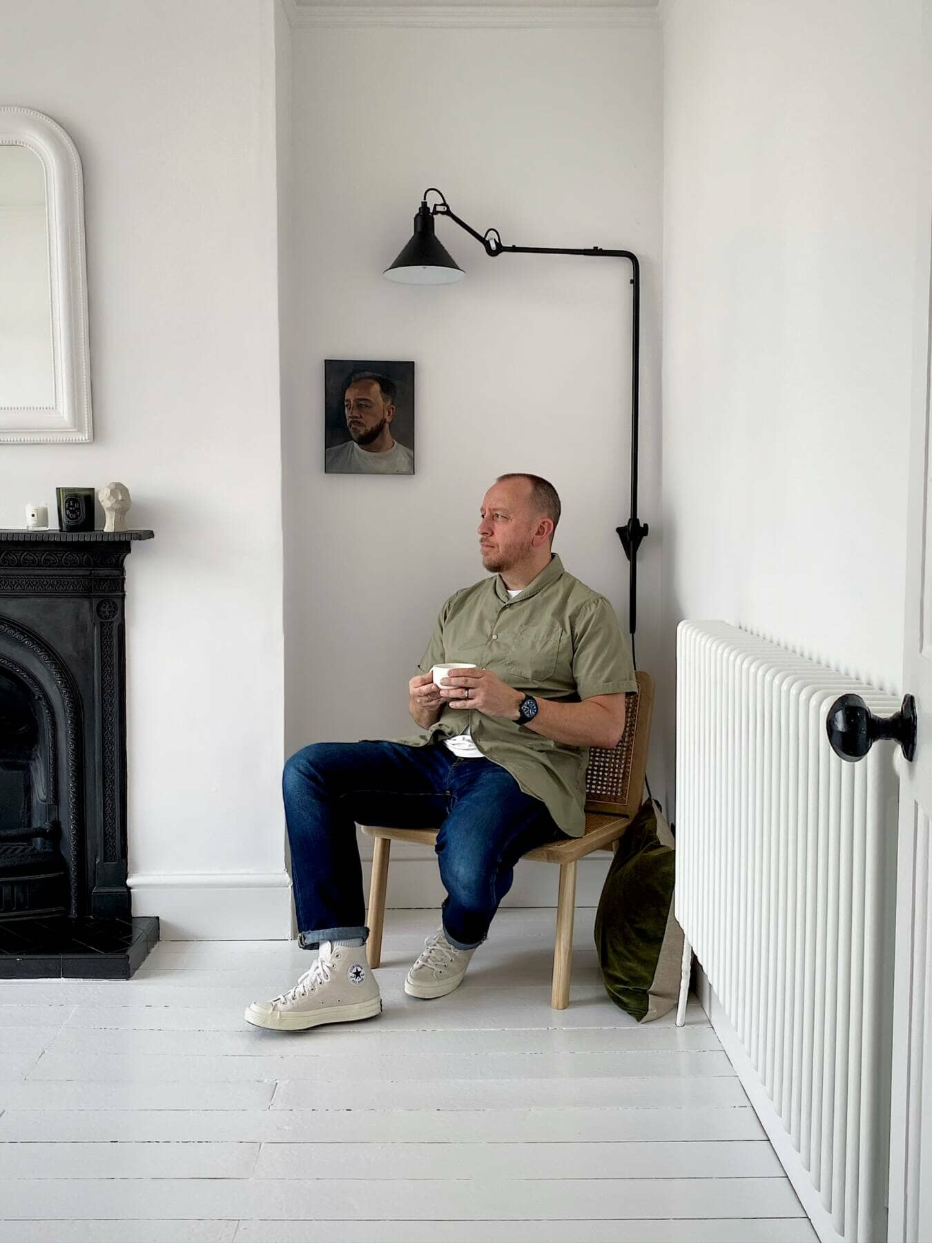 Donna's husband sat on a chair in the living room next to the radiator