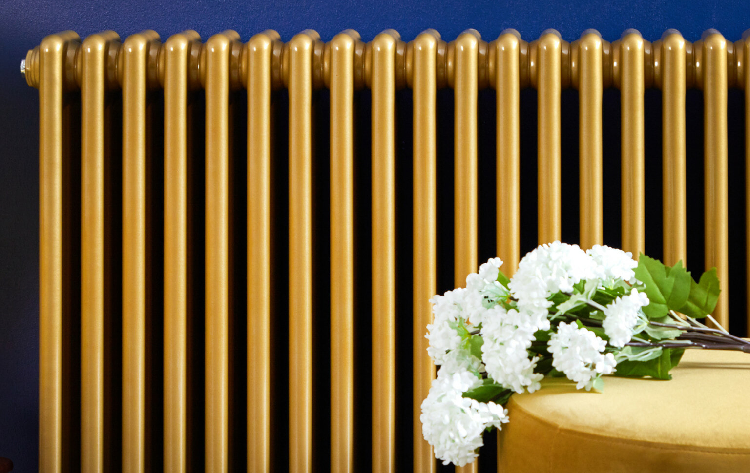 front of a Milano Windsor gold radiator