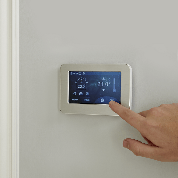 A milano compact thermostat being used on a wall