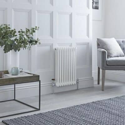small white column radiator in a living room