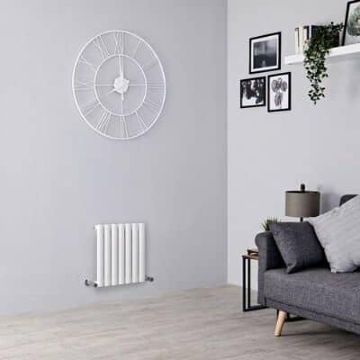 small aruba radiator in a grey living room