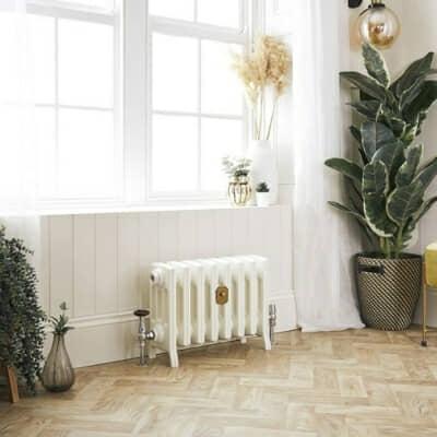 small cast iron radiator in a bathroom