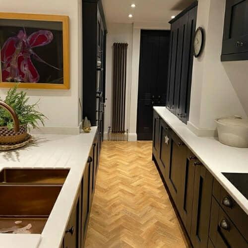 bronze vertical radiator in a modern kitchen