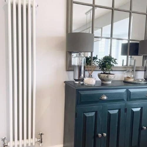 white vertical column radiator in a period home