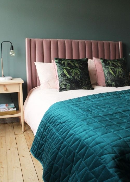 bed with a pink headboard