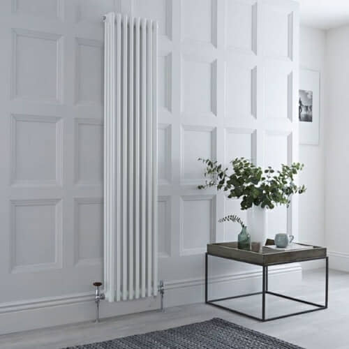 dual fuel vertical column radiator on a panelled wall
