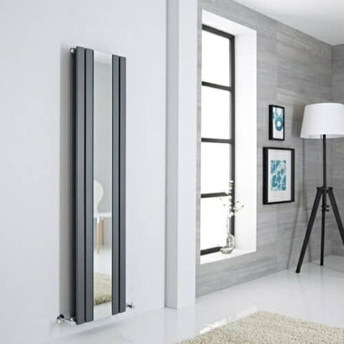 vertical mirrored radiator in a minimal room