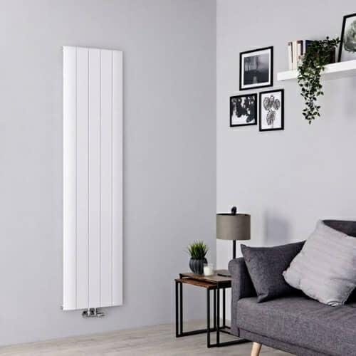 vertical aluminium radiator in a grey living room