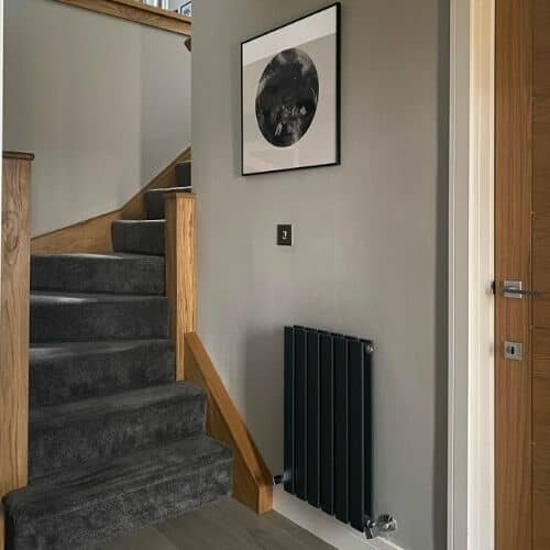 small anthracite radiator in a hallway