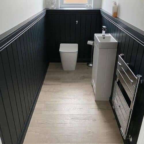modern chrome towel rail in a cloakroom