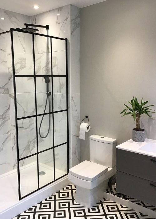 black grid style shower in a modern bathroom