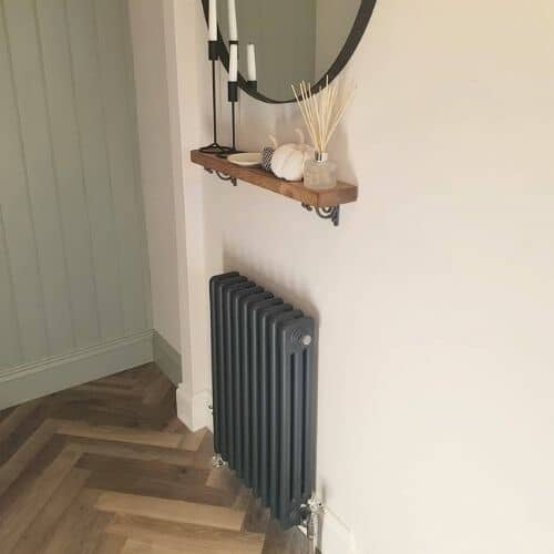 anthracite column radiator in a boot room
