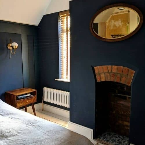 low level column radiator in a small bedroom
