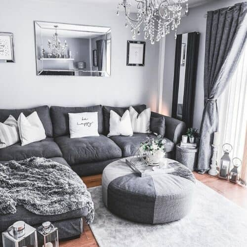 vertical mirrored radiator in a grey living room