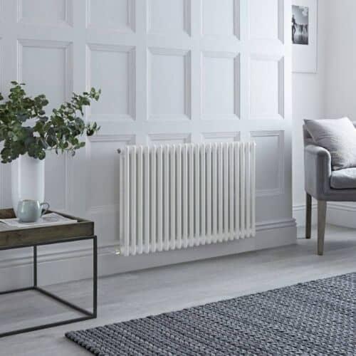 milano windsor electric column radiator in a grey living room