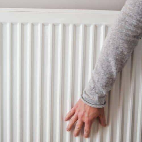 hand on the bottom of a radiator