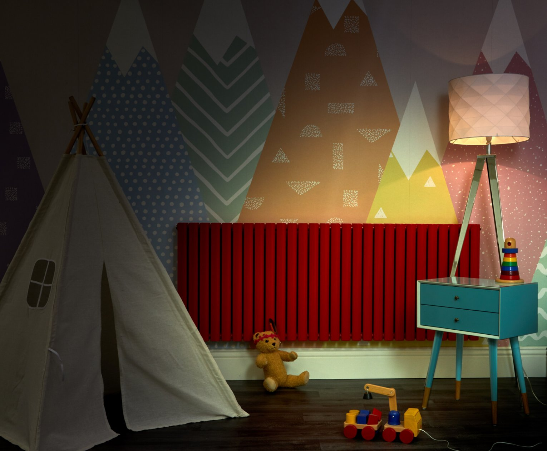 red Aruba radiator in a playroom